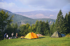 Tourist tents in forest Stock Photos
