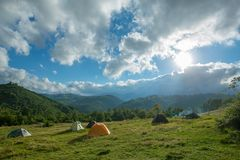 Tourist tents in a mountains Royalty Free Stock Photos