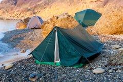 Tourist tents near sea Stock Photos