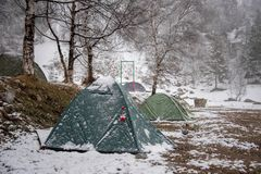 Tourist tents stand in a snow covered camp. In early spring royalty free stock images