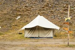 Tourist tent in trekking camping with pointers. stock photo