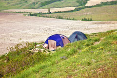 Tourist tents on verge of plateau Stock Image