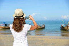 Tourist on thai beach at Krabi taking photo with smartphone Royalty Free Stock Photos