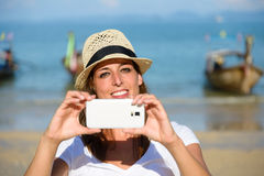 Tourist on Thailand travel taking photo with smartphone at Krabi Stock Photography