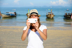 Tourist on Thailand travel taking photos with smartphone at Krab Royalty Free Stock Photography