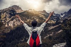 Tourist with hands up stands on the background of a mountain landscape. Tourist with their hands up stands on the background of a mountain landscape Stock Photography