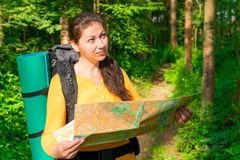 Tourist thinks your route through the woods Stock Image