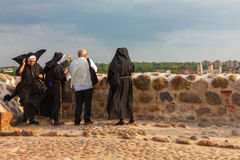 Tourist and three nuns admire the view from Castle Royalty Free Stock Image