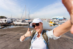 Tourist thumb up Stock Photos