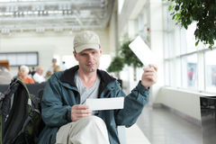 Tourist with tickets stock photography