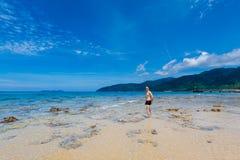 Tourist on Tioman island Malaysia. Landscape with young tourist on tropical Tioman island in Malaysia. Beautiful seascape of south east asia on Tekek beach Stock Images
