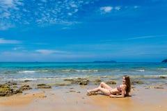 Tourist on Tioman island Malaysia. Landscape with young tourist on tropical Tioman island in Malaysia. Beautiful seascape of south east asia on Tekek beach Stock Photo