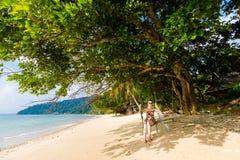 Tourist on Tioman island Malaysia. Tourist on tropical Tioman island in Malaysia. Beautiful seascape of south east asia Royalty Free Stock Photos