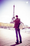 Tourist To Paris Taking Pictures Of The Eiffel Tower royalty free stock photo