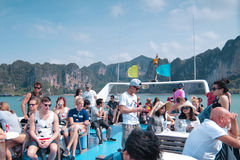 Tourist at top of a boat. KRABI, THAILAND - 2 MARCH 2016 - Tourist from all over the world at top deck. Thailand is popular spot for tourist attraction in asia Stock Image