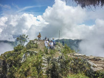 Tourist at the Top of Machu Picchu Mountain Royalty Free Stock Photo