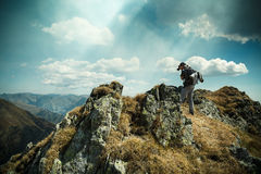 Tourist on top of the mountain Stock Image