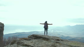 Tourist on top of mountain. Girl in raincoat relax. And enjoy beautiful panorama of mountain ranges. Stormy weather. Mountain landscape stock video footage