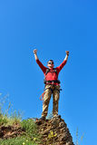 Tourist on top of mountain Stock Photography