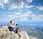 Tourist on top of a mountain Stock Photography