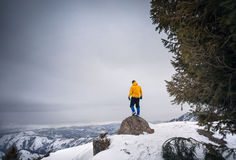 Tourist on the top of snow mountain Stock Images