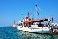 Tourist tour boat and lighthouse, Chania. Royalty Free Stock Images