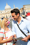 Tourist tour in Rome. Tourists with map in front of Saint Peter's Basilica in Rome Stock Photos
