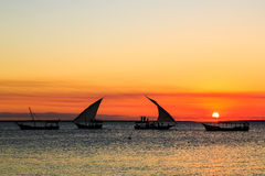Tourist on a traditional fishermans boat watching the sunset Royalty Free Stock Photo