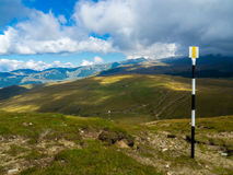 Tourist trail in Bucegi Mountains. Yellow band marks the tourist trail on Bucegi plateau, from Cota 2000 to Omu peak Royalty Free Stock Photo