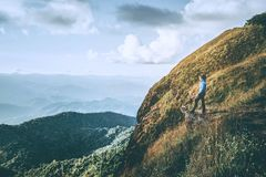 Tourist trail hiking in the forest Traveler Man Relax and crossing the mountain Traveler concept.  royalty free stock image
