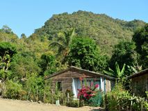 Tourist trail for the Pico Turquino tops. Wooden house in one of villages by the trail for the highest peak on Cuba Pico Turquino, mountain range Sierra Maestra Stock Image