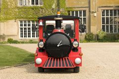 Tourist train. A red and black train that runs on the road Royalty Free Stock Photos