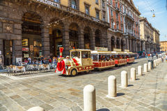Tourist train Bologna. Bologna, Italy - May 28, 2016: tourist train in via Rizzoli, closed to traffic on Saturday, while taking tourists around the historic Stock Photos
