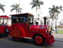 Tourist train locomotive and the Lima Cathedral Stock Photos