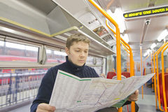 Tourist in train. Tourist man reading map in train Stock Image
