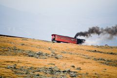 Tourist Train on Mt Washington in a Fall Cloudy Day Royalty Free Stock Photo