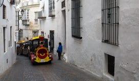 Tourist train on the narrow streets Stock Photo