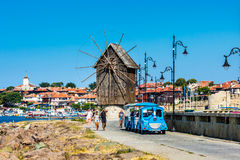 Tourist train near old windmill in Nessebar in Bulgaria Royalty Free Stock Image