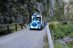 Tourist train in the Serrai di sottoguda canyon, Veneto, Italy. Royalty Free Stock Photo