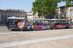 Tourist train through the streets of the city of Avignon, France royalty free stock photography