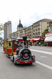 Tourist train in a town, the alps, switzerland Stock Image
