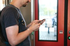 A tourist on the train uses a mobile phone. stock photo