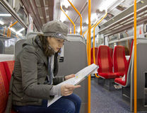 Tourist in train. Tourist woman reading map in train Stock Images