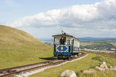 Tourist tram approaching the summit of the Great Orme Llandudno. Royalty Free Stock Photo