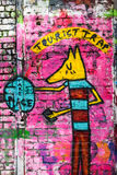 Tourist trap, graffiti wall art, London UK. Tourist trap dog face graffiti wall art,  London UK Stock Photos