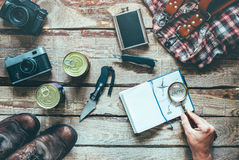 Tourist And Travel Accessories On Wooden Table, Top View. Trip plan Royalty Free Stock Photos