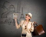 Tourist travel around the world. Beautiful woman tourist with landmarks from different cities on the background, concept - travel around the world stock image