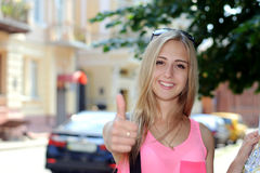 Tourist travel is happy and smiling holding a map Royalty Free Stock Photo