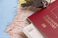 Tourist and travel packages - Russian passport, euro, maps, house keys and cars. Travel and tourist packages - Russian passport, euro, maps, house keys and stock image