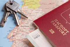 Tourist and travel packages - Russian passport, euro, maps, house keys and cars. Travel and tourist packages - Russian passport, euro, maps, house keys and royalty free stock photography